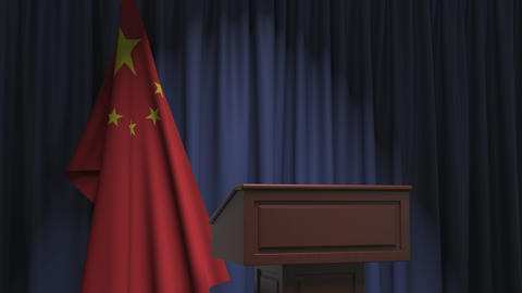Flag of China and speaker podium tribune. Political event or statement related Live Action