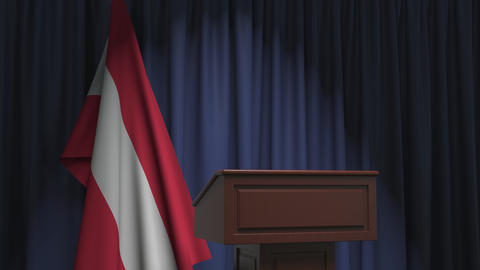 Flag of Austria and speaker podium tribune. Political event or statement related Live Action