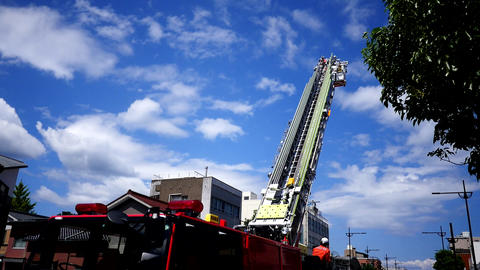 fire fighter and fire brigade raising the crane of the fire engine in training action Live Action