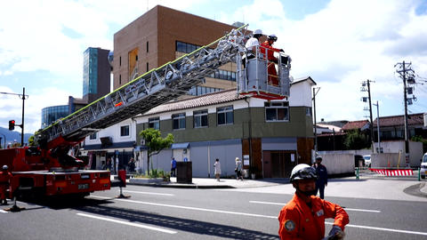 Narita, Japan, 10th of Nov 2019, fire fighter and fire brigade raising the crane of the fire engine Live Action