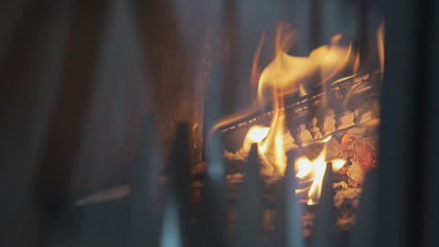 Close-up shot of warm cozy burning fire in a brick fireplace ビデオ