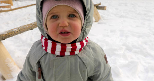 Little girl weeping in winter time Archivo