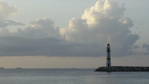 Seascape at sunset. Lighthouse on the coast. Seaside town of Turgutreis and spectacular sunsets Archivo