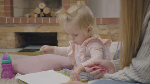 Portrait of charming little Caucasian baby girl sitting at the background of Footage