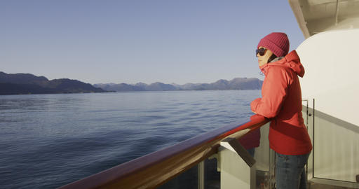 Alaska cruise ship travel tourist woman watching nature landscape - Glacier Bay Footage