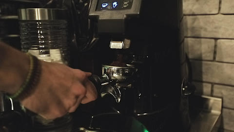 Making espresso in a cafe. Barista making coffee using espresso machine. Making Live Action