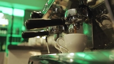 Drinking roasted black coffee in the morning. Pouring Coffee Stream from Footage