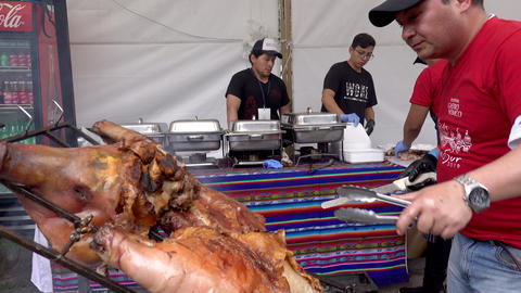 Cuenca, Ecuador - 2019-11-02 - Cuenca Days Street Fair - Pork is Cut From Whole Archivo