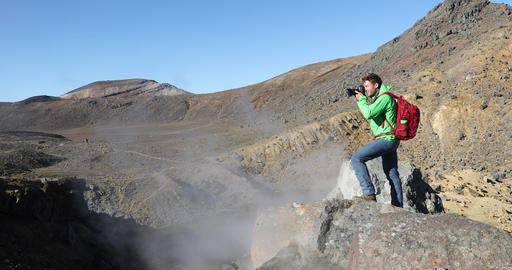 Travel Hiker Taking Landscape Picture On Active Volcano Mountain With DSLR Archivo