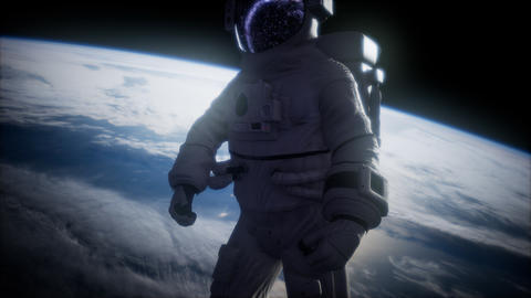 Astronaut in outer space against the backdrop of the planet earth GIF