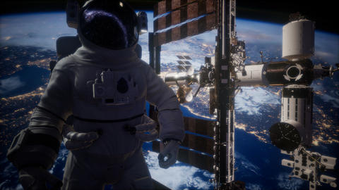 International Space Station and astronaut in outer space over the planet Earth GIF