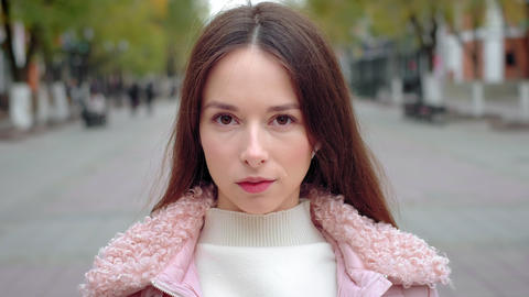 Portrait young attractive smile woman. Look at camera at city center. Feel happy Footage