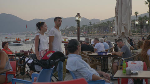 Marmaris, Turkey - September 23, 2019: tourist people relaxing in evening cafe Footage