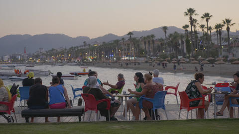 Marmaris, Turkey - September 23, 2019: visitors discussing in outdoor cafe Live Action