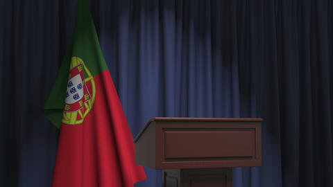 Flag of Portugal and speaker podium tribune. Political event or statement Live Action