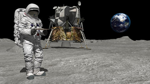 Astronaut on the moon typing on a laptop ビデオ
