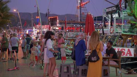 Marmaris, Turkey - September 23, 2019: tourist people walking on sea promenade GIF