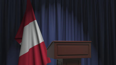 Flag of Peru and speaker podium tribune. Political event or statement related Live Action