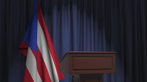Flag of Puerto Rico and speaker podium tribune. Political event or statement Live Action