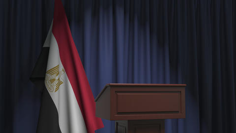 National flag of Egypt and speaker podium tribune. Political event or statement Live Action