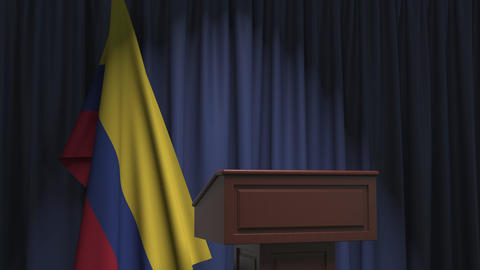 Flag of Colombia and speaker podium tribune. Political event or statement Live Action