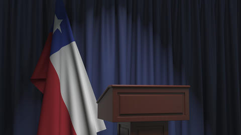 Flag of Chile and speaker podium tribune. Political event or statement related Live Action