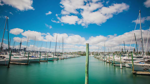 Time Lapse - Beautiful Clouds Moving Over Boats in Harbor Footage