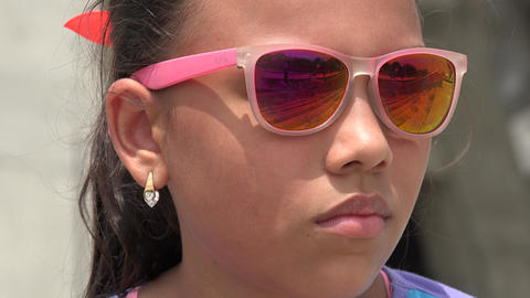 Young Girl Wearing Sunglasses Live Action