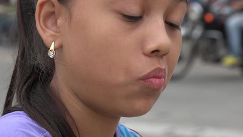 Girl Eating Chocolate Snack Footage
