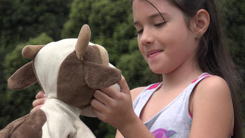 Girl Playing With Teddy Bear stock footage