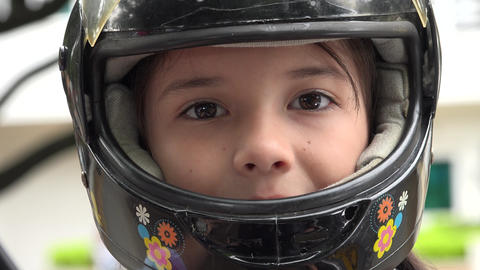 Child Wearing Motorcycle Helmet Live Action