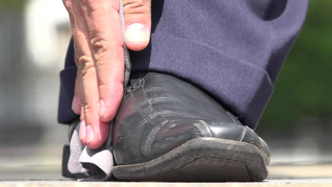 Man Shining his Shoes Footage