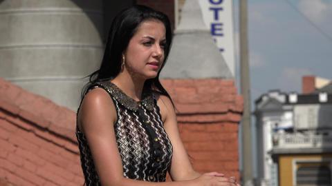 Hispanic Woman in Urban Area Live Action