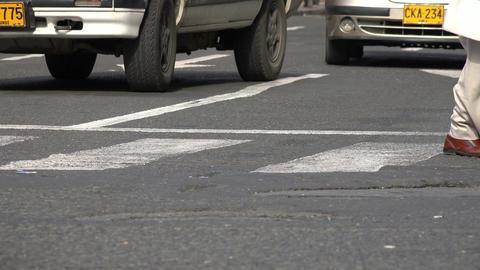 Pedestrians Crossing Crosswalk and Traffic Footage