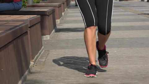 Woman Jogging in Urban Park Live Action