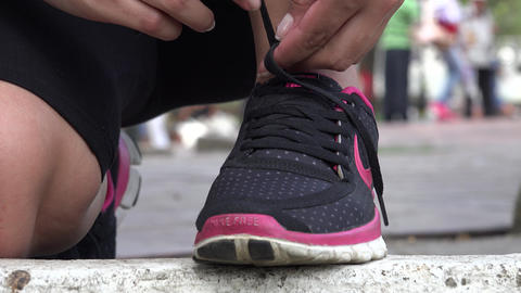 Woman Tying Athletic Shoes Live Action
