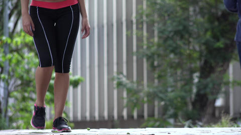Fit Young Female Jogger Walking Live Action