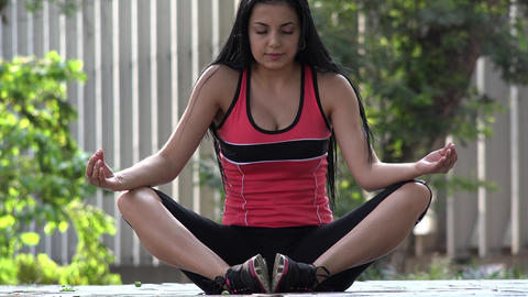 Fit Young Woman Meditating Live Action