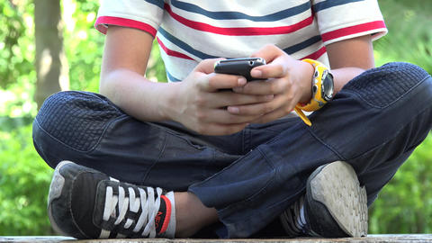 Hispanic Boy Using Cell Phone Live Action