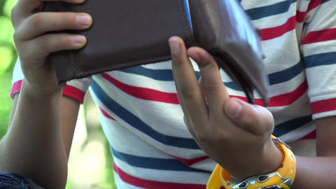 Hispanic Boy Openning Wallet or Billfold Live Action