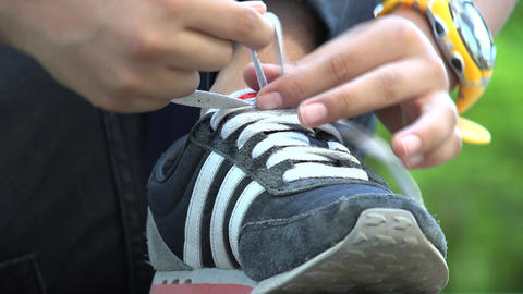 Young Boy Tying His Shoes Live Action