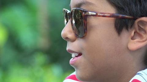 Hispanic Boy Wearing Sunglasses Live Action