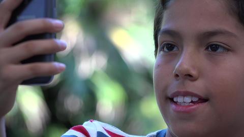 Hispanic Boy Taking Selfie Live Action