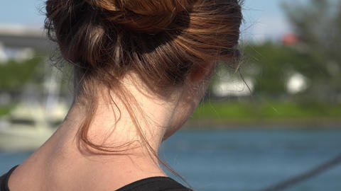 Woman Watching Boats Pass By Footage