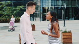 Young black woman quarreling with her husband on the street ビデオ