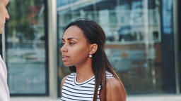 Close-up of young black lady quarreling with her boyfriend in the street and GIF