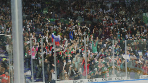 hockey fans do wave rising with flags and scarfs slow motion GIF