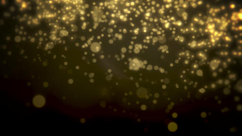 Abstract yellow bokeh and particles falling. Happy New Year and Merry Christmas shiny background Animation