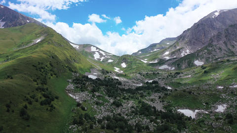 Aerial view of Mountain pass in Adygea, valley and mountain ridge. Green trees Live Action