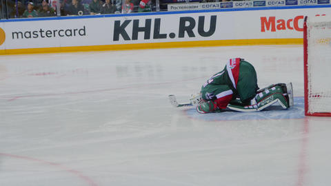 goalkeeper in uniform near gate at hockey match on arena ビデオ